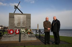 The Mayor of Mid and East Antrim Borough, Councillor Billy Ashe pictured at the Princess Victoria Memorial in Larne with William McAllister who is the only living survivor of the of disaster.