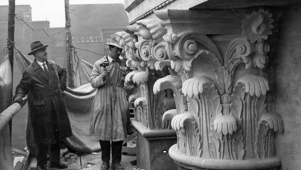 Stonemasons finish work on the outside of the Royal Courts of Justice, Oxford Street, Belfast.  April 1933 BELFAST TELEGRAPH ARCHIVE