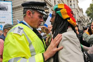 Police officers push back demonstrators during a protest against the visit of Israel's Prime Minister Benjamin Netanyahu to Britain, in front of Downing Street in London, Wednesday, Sept. 9, 2015. (AP Photo/Frank Augstein)