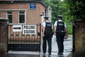 PSNI officers walk into the South Belfast Polling Station at St Nicolas Parish Hall, Belfast, as voting gets underway in the 2017 General Election. Liam McBurney/PA Wire