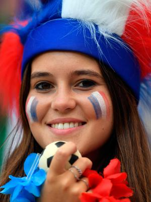 A France's fan smiles before the Russia 2018 World Cup Group C football match between Denmark and France at the Luzhniki Stadium in Moscow on June 26, 2018.