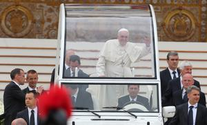 Pope Francis waves to the faithful in St Peter's Square in Rome after the  historic canonisation of Popes John XXIII and John Paul II. Niall Carson/PA Wire