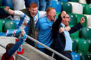 Ballymena United fans celebrate in the stands during the Sadler's Peaky Blinders Irish Cup Final match at Windsor Park, Belfast. PA Photo. Picture date: Friday July 31, 2020. Friday's Irish Cup final between Ballymena United and Glentoran is the first football match in the UK to be played in front of spectators since March. Photo credit should read: Liam McBurney/PA Wire