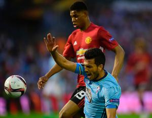 Celta Vigo's Argentinian defender Gustavo Cabral (front) vies with Manchester United's forward Marcus Rashford during their UEFA Europa League semi final first leg football match RC Celta de Vigo vs Manchester United FC at the Balaidos stadium in Vigo on May 4, 2017. / AFP PHOTO / MIGUEL RIOPAMIGUEL RIOPA/AFP/Getty Images