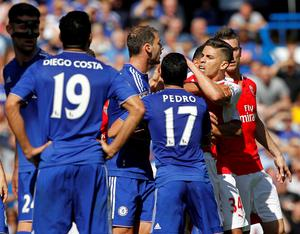 Arsenal's Brazilian defender Gabriel (2nd R) reacts after being sent off by referee Mike Dean (not pictured) during the English Premier League football match between Chelsea and Arsenal at Stamford Bridge in London on September 19, 2015. AFP PHOTO / IAN KINGTON   RESTRICTED TO EDITORIAL USE. No use with unauthorized audio, video, data, fixture lists, club/league logos or 'live' services. Online in-match use limited to 75 images, no video emulation. No use in betting, games or single club/league/player publications.IAN KINGTON/AFP/Getty Images