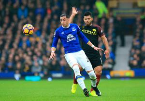 "Everton's Ramiro Funes Mori (left) and Manchester City's Sergio Aguero battle for the ball during the Premier League match at Goodison Park, Liverpool. PRESS ASSOCIATION Photo. Picture date: Sunday January 15, 2017. See PA story SOCCER Everton. Photo credit should read: Peter Byrne/PA Wire. RESTRICTIONS: EDITORIAL USE ONLY No use with unauthorised audio, video, data, fixture lists, club/league logos or ""live"" services. Online in-match use limited to 75 images, no video emulation. No use in betting, games or single club/league/player publications."