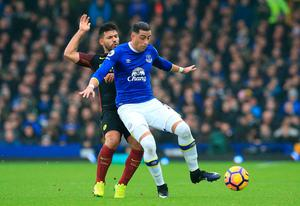 "Manchester City's Sergio Aguero (left) and Everton's Ramiro Funes Mori battle for the ball during the Premier League match at Goodison Park, Liverpool. PRESS ASSOCIATION Photo. Picture date: Sunday January 15, 2017. See PA story SOCCER Everton. Photo credit should read: Peter Byrne/PA Wire. RESTRICTIONS: EDITORIAL USE ONLY No use with unauthorised audio, video, data, fixture lists, club/league logos or ""live"" services. Online in-match use limited to 75 images, no video emulation. No use in betting, games or single club/league/player publications."