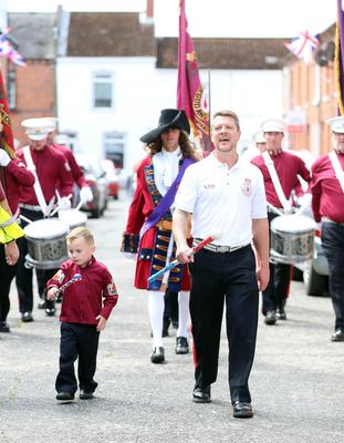 PACEMAKER, BELFAST, 13/7/2020: Leading the Shankill Protestant Boys Flute Band as they parade around the streets in the Shankill area of Belfast today. The Orange Order did not take part in their traditional Twelfth of July processions this year because of the restrictions around Coronavirus but there were band parades around local areas across Northern Ireland. PICTURE BY STEPHEN DAVISON