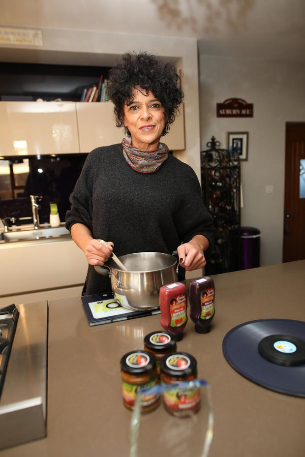 Taste of success: Carolyn Stewart cooking in the kitchen with some of the sauces that she has developed