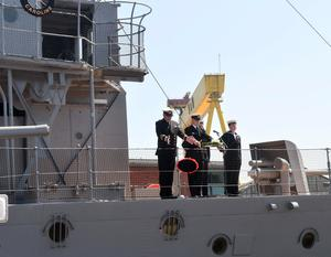 Pacemaker Press 31/5/2016 Wreaths are thrown overboard during The commemoration that took place  takes  place at HMS Caroline on the centenary of the Battle of Jutland, as Belfast hosts a special all-island commemoration for Irish sailors who died in World War One. Pic Colm Lenaghan/Pacemaker