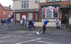 PACEMAKER BELFAST  13/07/2015  Loyalist bandsmen and their supporters clash with PSNI riot police at the top of the Woodvale Road this evening. Bottles and bricks have been thrown at police lines when marchers were prevented from returning along the Ardoyne/Crumlin road this evening.