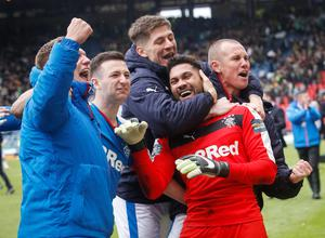 Rangers' players mob goalkeeper Wes Foderingham as they celebrate victory after the William Hill Scottish Cup semi-final match at Hampden Park, Glasgow. Picture date: Sunday April 17, 2016. See PA story SOCCER Rangers. Photo credit should read: Danny Lawson/PA Wire. EDITORIAL USE ONLY