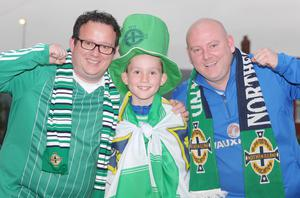 Northern Ireland v Hungary at Windsor Park, Belfast.  Northern Ireland fans Mark Paul with his son Rhys and Gary from Newtownabbey. Picture by Jonathan Porter/PressEye