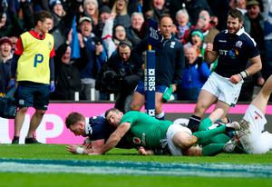 Scotland's Stuart Hogg scores his side's first try during the RBS 6 Nations match at BT Murrayfield Stadium, Edinburgh. PRESS ASSOCIATION Photo. Picture date: Saturday February 4, 2017. See PA story RUGBYU Scotland. Photo credit should read: Jane Barlow/PA Wire. RESTRICTIONS: Editorial use only, No commercial use without prior permission.