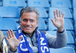 A supporters wearing a Jose Mourinho mask waves from his seat ahead of the English Premier League football match between Chelsea and Liverpool at Stamford Bridge in London on October 31, 2015. AFP/Getty Images