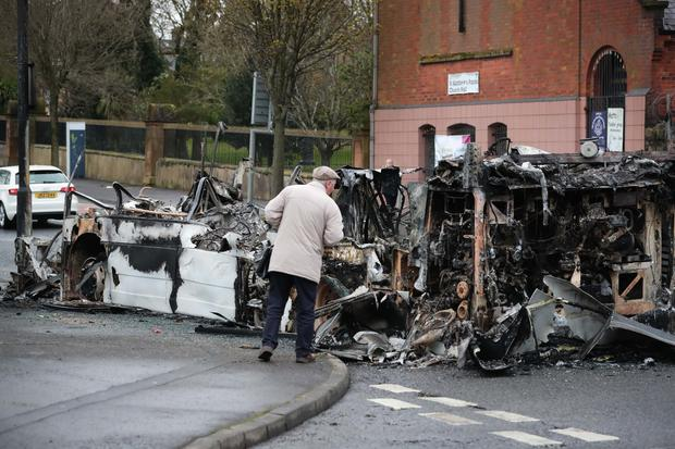 General view of a burnt out bus on Belfast's Shankill Road.   Disruption has been taking place close to where a number of loyalist protesters had earlier gathered.  Police confirmed a vehicle was set alight at the junction of Lanark Way and the Shankill Road in the west of the city.  Protests have been taking place across Northern Ireland by loyalists in the past week.   Photo by Kelvin Boyes / Press Eye.