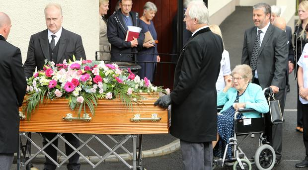 Maureen Luke (in wheelchair), a relative of Maud, at the funeral