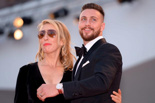 "Actor Aaron Taylor-Johnson arrives with his wife Sam Taylor-Johnson for the premiere of the movie ""Nocturnal Animals"" presented in competition at the 73rd Venice Film Festival on September 2, 2016 at Venice Lido. / AFP PHOTO / FILIPPO MONTEFORTEFILIPPO MONTEFORTE/AFP/Getty Images"