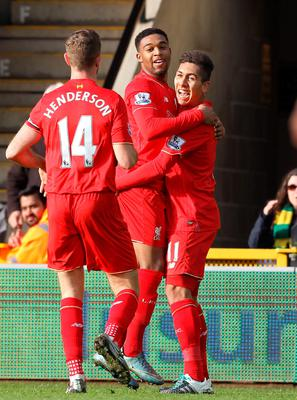 Liverpool's Brazilian midfielder Roberto Firmino (R) celebrates with Liverpool's English midfielder Jordan Henderson and Liverpool's English midfielder Jordon Ibe (C) after scoring the opening goal of the English Premier League football match between Norwich City and Liverpool at Carrow Road in Norwich, eastern England, on January 23, 2016. AFP PHOTO / LINDSEY PARNABY  RESTRICTED TO EDITORIAL USE. No use with unauthorized audio, video, data, fixture lists, club/league logos or 'live' services. Online in-match use limited to 75 images, no video emulation. No use in betting, games or single club/league/player publications.LINDSEY PARNABY/AFP/Getty Images