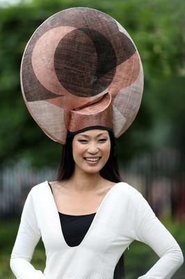 Wei Lin from Taiwan on Ladies' Day of the Royal Ascot meeting at Ascot Racecourse, Berkshire. PRESS ASSOCIATION Photo. Picture date: Thursday June 20, 2013. See PA story RACING Ascot. Photo credit should read: John Walton/PA Wire