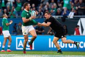 CHICAGO, IL - NOVEMBER 05:  Robbie Henshaw of Ireland is snagged by Dane Coles of New Zealand during the international match between Ireland and New Zealand at Soldier Field on November 5, 2016 in Chicago, United States.  (Photo by Phil Walter/Getty Images)