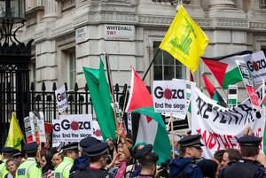 Pro-palestinian demonstrators carry Palestinian flags, placards and the yellow flag of Lebanese Shiite militant group Hezbollah as they protest against a planned visit of Israeli Prime Minister Benjamin Netanyahu outside the gates of Downing Street in London on September 9, 2015. Over 100 pro-Israeli demonstrators and hundreds of pro-Palestinian activists rallied in front of Downing Street in London ahead of a planned visit of Israeli Prime Minister Benjamin Netanyahu. Netanyahu visits Britain this week for talks with his counterpart David Cameron as the right-wing Israeli leader faces diplomatic pressure over West Bank settlements and stalled peace efforts. AFP PHOTO / JUSTIN TALLISJUSTIN TALLIS/AFP/Getty Images