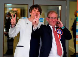 DUP leader Arlene Foster (L) gives a victory sign alongside DUP chairman and fellow candidate Lord Morrow (R) after being elected at the Northern Ireland Assembly count at Omagh Leisure on May 6, 2016 in Omagh, Northern Ireland. (Photo by Charles McQuillan/Getty Images)