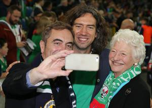 Press Eye - Belfast - Northern Ireland - 8th October 2016 -Picture by Brian Little/PressEye  Selfie time for Actor  James Nesbitt, Snow Patrol's Gary Lightbody and Dame Mary Peters  attending The National Football Stadium at Windsor Park Opening Game and Ceremony before Northern Ireland vs San Marino 2018 FIFA World Cup Qualifier Photo by Brian Little/ Press Eye