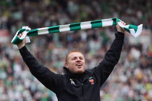 KILMARNOCK, SCOTLAND - APRIL 07:  Coach Neil Lennon of Celtic celebrates following his team clinching the Scottish Clydesdale Bank Scottish Premier League title after the match between Kilmarnock and Celtic at Rugby Park on April 7, 2012 in Kilmarnock, Scotland.  (Photo by Jeff J Mitchell/Getty Images)