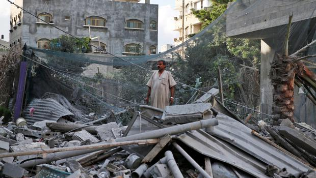 A Palestinian inspects the rubble from a damaged house following an overnight Israeli missile strike in Gaza City, Tuesday, July 15, 2014. Egypt presented a cease-fire plan Monday to end a week of heavy fighting between Israel and Hamas militants in the Gaza Strip that has left at least 185 people dead, and both sides said they were seriously considering the proposal. The late-night offer by Egypt marked the first sign of a breakthrough in international efforts to end the conflict. (AP Photo/Lefteris Pitarakis)
