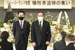 Family members and students attend a memorial ceremony at Toyama Foreign Language College (Kyodo News/AP)