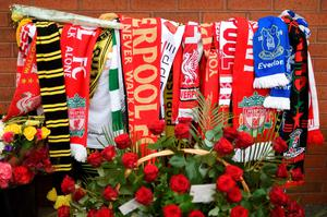 Flowers and football scarves are pictured at the temporary Hillsborough memorial, ahead of a memorial service at Anfield in Liverpool, north west Engand on April 15, 2016, on the 27th anniversary of the Hillsborough Disaster. 96 Liverpool supporters died at the 1989 FA Cup semi-final between Liverpool and Nottingham Forest at the Hillsborough football ground in Sheffield, northern England. 2016 will be the final year a memorial service is held at Anfield. / AFP PHOTO / PAUL ELLISPAUL ELLIS/AFP/Getty Images