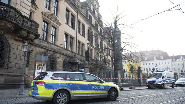 Police cars stand in front of the Residenzschloss, Residence Palace, building in Dresden (Sebastian Kahnert/dpa via AP)