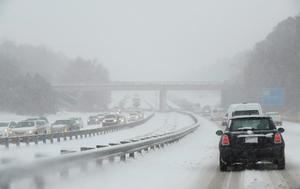 DURHAM, NC - FEBRUARY 12: Traffic on Durham Freeway 147 creeps along as compacted snow turns into ice on February 12, 2014 in Durham, North Carolina. Snow fell hard and fast in central North Carolina, resulting in abandoned cars and vehicular accidents by mid-afternoon. (Photo by Sara D. Davis/Getty Images)because