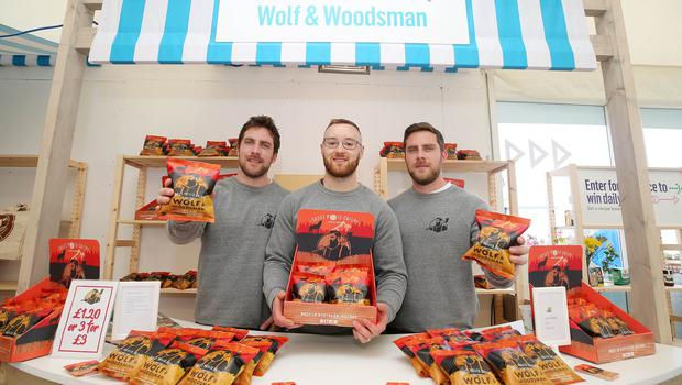 Press Eye - Belfast - Northern Ireland - 15th May 2019  First day of the Balmoral Show, in partnership with Ulster Bank.  Pictured at Balmoral Park, outside Lisburn, are(L-R) Andy Laverty, David Knowles and Jonny Laverty with their sweet potato crisps business Wolf and Woodsman.  Ulster Bank has provided space in its market at Balmoral Show to entrepreneurs from Ulster Bank's Entrepreneur Accelerator programme as well as small business customers.    Picture by Jonathan Porter/PressEye