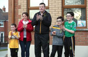 Applauding the people who saved his life. Belfast lawyer and Coronavirus survivor Niall Murphy applauds the NHS and frontline staff with his family Aoibhinn, Marie, Fionntan and Mcnas. Credit: Pacemaker