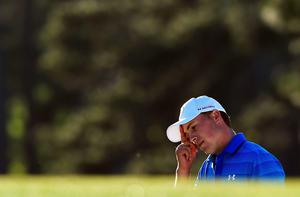 US golfer Jordan Spieth reacts on the 17th hole during Round 4 of the 80th Masters Golf Tournament at the Augusta National Golf Club on April 10, 2016, in Augusta, Georgia. England's Danny Willett won the 80th Masters at Augusta National on Sunday for his first major title. He was trailing defending champion Jordan Spieth by five strokes around the turn, but stormed down the back nine to overhaul the American. Willett is the first Englishman since Nick Faldo 20 years ago to win the Masters and only the second all-time. / AFP PHOTO / DON EMMERTDON EMMERT/AFP/Getty Images