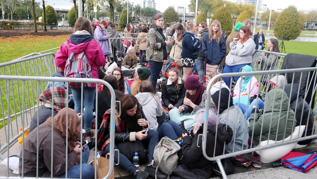 Press Eye - Belfast - Northern Ireland - 21st October 2015  One Direction fans queue up at the SSE Arena in Belfast ahead of tonight's concert.  The boy band, who are playing three nights in Belfast, cancelled last nights gig at the last minute.  The group made an announcement around lunch time to say they were going ahead with the rest of the shows and are rescheduling the canceled performance to Friday night.    Picture by Jonathan Porter/PressEye