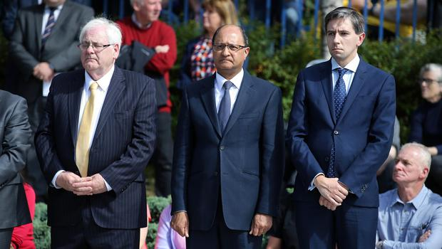 Press Eye - Belfast - Northern Ireland - 12th August 2018 -  Minister of State for Northern Ireland, Shailesh Vara MP and Irish Minister Simin Harris with Michael Gallagher in the Omagh Bomb Memorial Service in the Memorial Garden of Light ahead of the 20th anniversary of the Omagh bombing.  Twenty-nine people - including a woman pregnant with twins - were killed in a car bomb attack in the County Tyrone town in 1998. It was carried out by the dissident republican Real IRA, several months after the signing of the Good Friday Agreement.   Photo by  Kelvin Boyes / Press Eye.