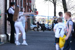 The scene on the Springfield Road in west Belfast after Tommy Crossan was shot dead on Good Friday, 2014. Picture by Kelvin Boyes / Press Eye