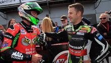 Glenn Irwin is congratulated by Jonathan Rea after winning the 2018 North West 200.