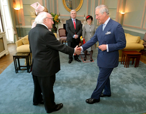 The President of Ireland Michael D Higgins shakes hands with the Prince Charles, Prince of Wales, as the Prince welcomed him to the UK for a five day state visit, at the Irish Embassy on April 8, 2014 in London, England. (Photo by John Stillwell - WPA Pool/Getty Images)