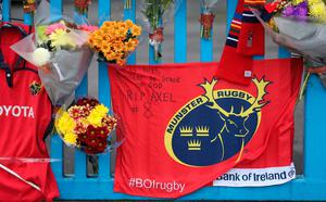 Tributes outside Thomond Park in Limerick placed by Munster Rugby fans after the death of head coach Anthony Foley.  Niall Carson/PA Wire