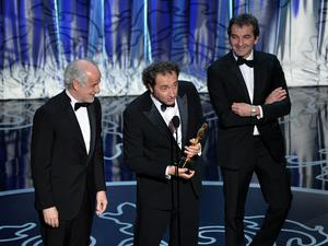 HOLLYWOOD, CA - MARCH 02:  (L-R) Actor Toni Servillo, director Paolo Sorrentino, and producer Nicola Giuliano accept the Best Foreign Language Film award for 'The Great Beauty' onstage during the Oscars at the Dolby Theatre on March 2, 2014 in Hollywood, California.  (Photo by Kevin Winter/Getty Images)