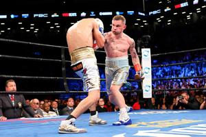 Carl Frampton, right, throws a punch at Leo Santa Cruz during their WBA Super World Featherweight Championship fight at the Barclays Center in the Brooklyn borough of New York on Saturday, July 30, 2016. Carl Frampton won via decision. (AP Photo/Steve Luciano)