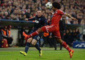 Manchester United's Wayne Rooney (left) and Bayern Munich's Dante battle for the ball during the Champions League, Quarter Final, Second Leg at the Allianz Arena, Munich, Germany.