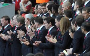 Liverpool's Steven Gerrard (top row, third left) stands with his team mates, during the Hillsborough 25th Anniversary Memorial Service at Anfield Stadium, Liverpool