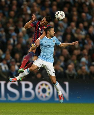 Manchester City's Gael Clichy (right) and Barcelona's Sanchez Alexis battle for the ball during the UEFA Champions League, Round of 16 match at the Etihad Stadium, Manchester. PRESS ASSOCIATION Photo. Picture date: Tuesday February 18, 2014. See PA story SOCCER Man City. Photo credit should read: Peter Byrne/PA Wire