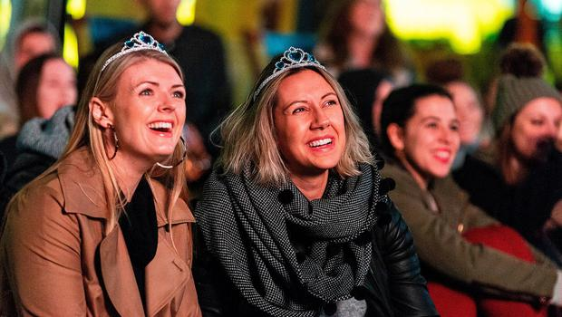 MELBOURNE, AUSTRALIA - MAY 19:  Spectators watch the Royal Wedding at Federation Square on May 19, 2018 in Melbourne, Australia. Australians enjoyed the Royal Wedding of Prince Harry and Meghan Markle televised live across the country on Saturday evening local time.  (Photo by Daniel Pockett/Getty Images)