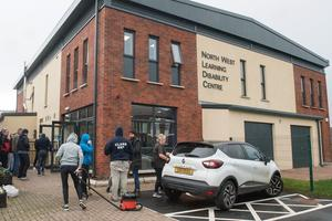 Th community came together to help out on Sunday with a clean up got underway in the North West Learning Disability Centre on Foyle Road in Derry which was attacked at the weekend. Picture Martin McKeown. 01.03.20